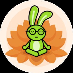 Veganary green rabbit sitting with hands on knees in orange lotus